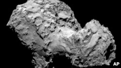 A picture of Comet 67P/Churymov Gerasimenko taken by the Rosetta spacecraft shows the objects rough surface.