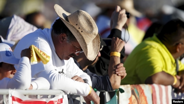 People attend the Mass celebrated by Pope Francis in Ciudad Juarez, Mexico, Feb. 17, 2016.