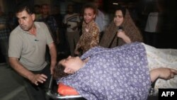 Palestinka ranjena u izraelskom bombaškom napadu na grad Gaza, 15. avgust, 2011.