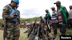 FILE - United Nations peace keepers record details of weapons recovered from the Democratic Forces for the Liberation of Rwanda (FDLR) militants after their surrender in Kateku,in Democratic Republic of Congo, May 2014.