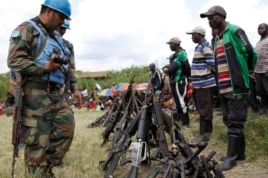 United Nations peace keepers record details of weapons recovered from the Democratic Forces for the Liberation of Rwanda (FDLR) militants after their surrender in Kateku, a small town in eastern region of the Democratic Republic of Congo, May 30, 20