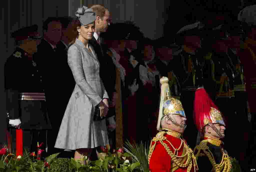 Britain's Catherine, Duchess of Cambridge, left, and Prince William, Duke of Cambridge, attend the welcome ceremony for Singapore's President Tony Tan Keng Yam at Horse Guards Parade in central London.