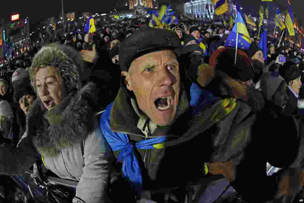 Pro-European Union activists shout as they listen to Ukranian opposition leader Oleh Tyahnybok, during a rally in the Independence Square in Kyiv, Ukraine, Dec. 13, 2013.