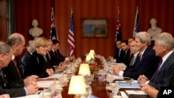 Australian Foreign Minister Julie Bishop, third from left, and Defense Minister David Johnston, second from left, meet with U.S. Secretary of State John Kerry, second from right, and U.S. Secretary of Defense Chuck Hagel, right, at the Australia-US Minist