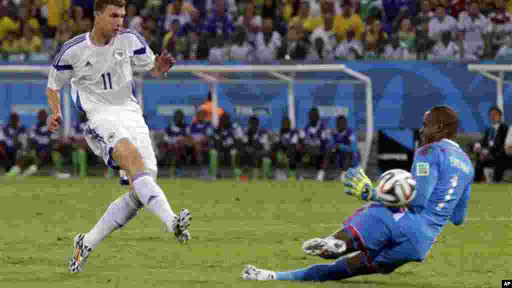 Nigeria's goalkeeper Vincent Enyeama makes a save on a shot by Bosnia's Edin Dzeko.