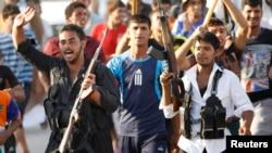 什葉派武裝人員星期六在巴格達遊行
