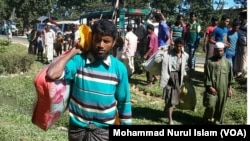 Rohingya men have just arrived from Myanmar, at an unidentified place in Cox's Bazar district, Bangladesh.