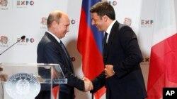 Президент России Владимир Путин и премьер-министр Италии Маттео Ренци. Милан, Италия. 10 июня 2015 г.