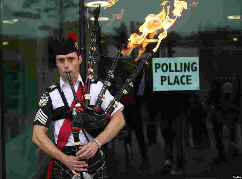 Ryan Randall plays the bagpipes outside a polling station in Edinburgh, Scotland. Scotland votes whether or not to end the 307-year-old union with the rest of the United Kingdom.
