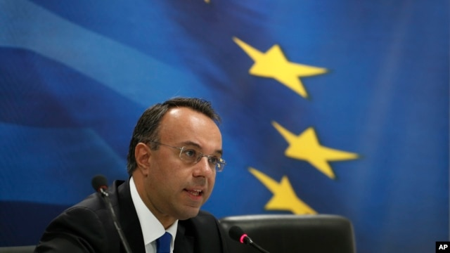 Deputy Finance Minister Christos Staikouras speaks during press conference in Athens, Oct. 7, 2013.