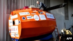 Jean-Jacques Savin, a former paratrooper, 71, works on the construction of a ship made from a barrel at the shipyard in Ares, southwestern France, Nov. 15, 2018. He is several days into his attempt to cross the Atlantic in a specially-built orange barrel, Dec. 31, 2018.
