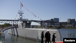 The autonomous ship Sea Hunter, developed by the Pentagon's Defense Advanced Research Projects Agency, is shown docked after its christening ceremony in Portland, Oregon, April 7, 2016. (REUTERS/Steve Dipaola)