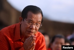 FILE - Cambodia's Prime Minister Hun Sen attends a ceremony at the Angkor Wat temple to pray for peace and stability in Cambodia, Dec. 3, 2017.