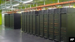 IT specialist Danny Rotscher checks the operating system of the High Performance Computing and Storage Complex II (HRSK-II) during the official opening of the new data center of the Lehmann Center (LZR) of the Dresden University of Technology in Dresden,