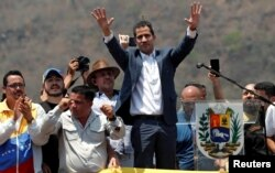 FILE - Venezuelan opposition leader Juan Guaido, who many nations have recognized as the country's rightful interim ruler, takes part in a rally against President Nicolas Maduro's government in Valencia, Venezuela, March 16, 2019.