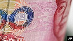 چین: یُوان کی قدر کم کرنے سے انکار