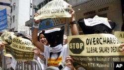 Indonesian migrant workers protest outside the Consulate General Indonesia in Hong KongCheck on May 6, 2007.