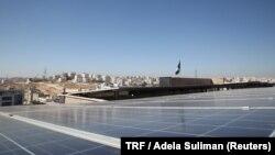 Solar panels look out across Amman city from the roof of the Al Hoffaz school in Amman, Jordan, Sept. 25, 2018.