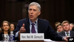 FILE - Supreme Court Justice nominee Neil Gorsuch speaks on Capitol Hill in Washington, March 21, 2017, during his confirmation hearing before the Senate Judiciary Committee.