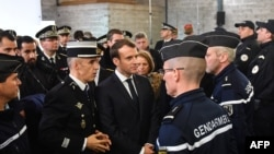 French President Emmanuel Macron (C) meets gendarmerie and police forces during his visit in the French northern city of Calais, Jan. 16, 2018.