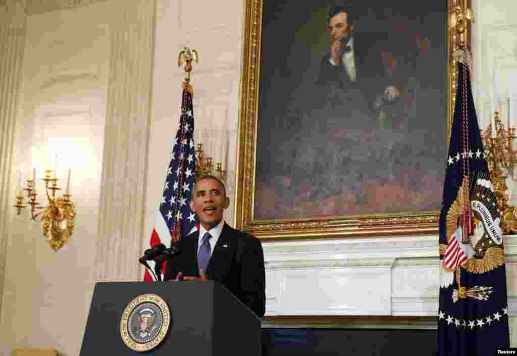 U.S. President Barack Obama talks about the humanitarian relief situation in Iraq inside the State Dining Room of the White House, in Washington, DC, Aug. 7, 2014.