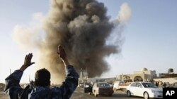 A rebel fighter reacts during an air strike in Ras Lanuf, March 7, 2011