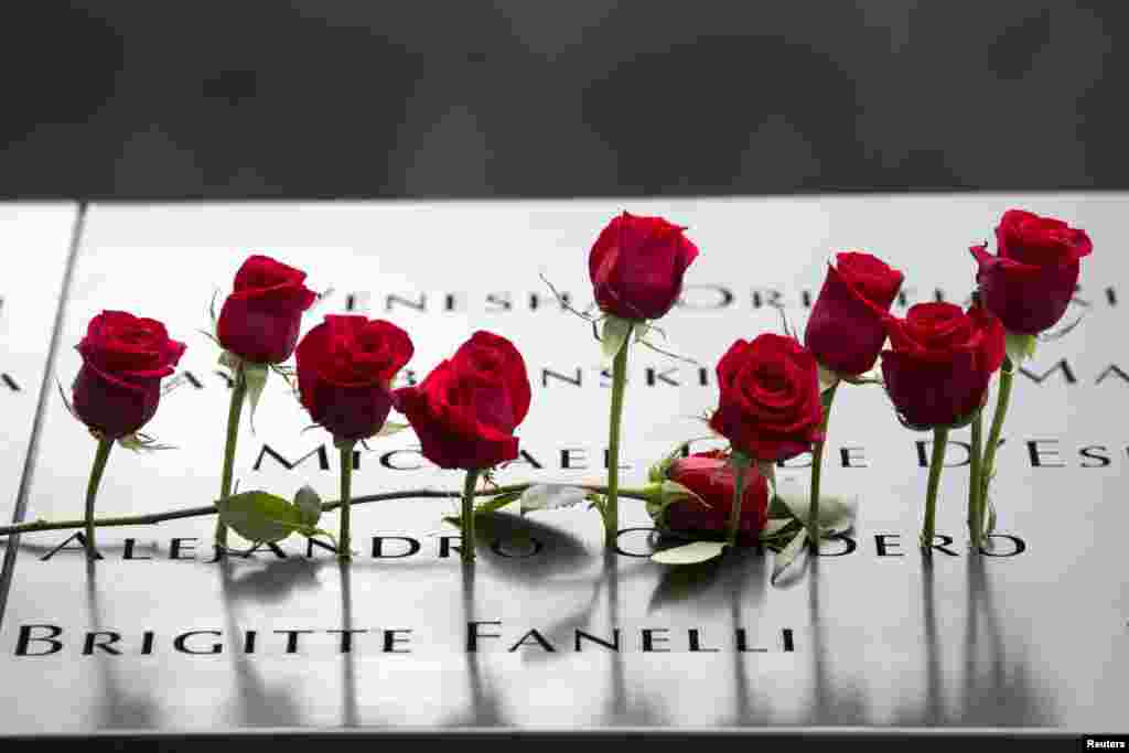 Roses are placed on the memorial during a ceremony marking the 14th anniversary of the attacks on the World Trade Center at The National September 11 Memorial and Museum in Lower Manhattan in New York.