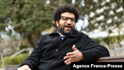 FILE - Sherif Mansour, summoned at age 17 to speak to Egyptian security, says his father described how to handle the interrogation, during an interview with AFP, Chevy Chase, Maryland, February 23, 2021.