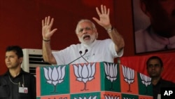 "FILE - Indian Prime Minister Narendra Modi, pictured at an election rally of his party in Kolkata in April 2016, says Pakistanis should question why their nation ""exports terrorists"" to the rest of the world."