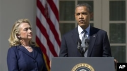 FILE - President Barack Obama, with then-Secretary of State Hillary Clinton, speaks in the Rose Garden of the White House, Sept. 12, 2012.