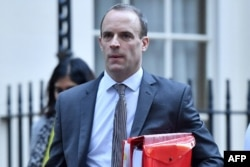 Britain's Secretary of State for Exiting the European Union (Brexit Minister) Dominic Raab leaves Downing Street in London, Nov. 14, 2018.