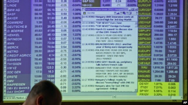 A dealer stands in the trading room of investment house BudaCash after bonds plunged further in a deepening crisis due to the government's widely-criticized policy course, in Budapest, Hungary, January 5, 2012.