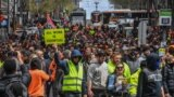 Construction workers and demonstrators attend a protest against COVID-19 regulations in Melbourne on Sept. 21, 2021.