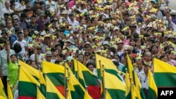 People wave the Myanmar national flag during a rally to show support to the Myanmar military in Yangon, May 5, 2019.