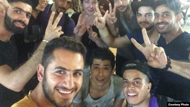 The guys pose for a photo in Izmir, Turkey, before meeting with smugglers, September 2015.