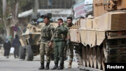 FILE - Turkish soldiers are seen in the center of Afrin, Syria, March 24, 2018.