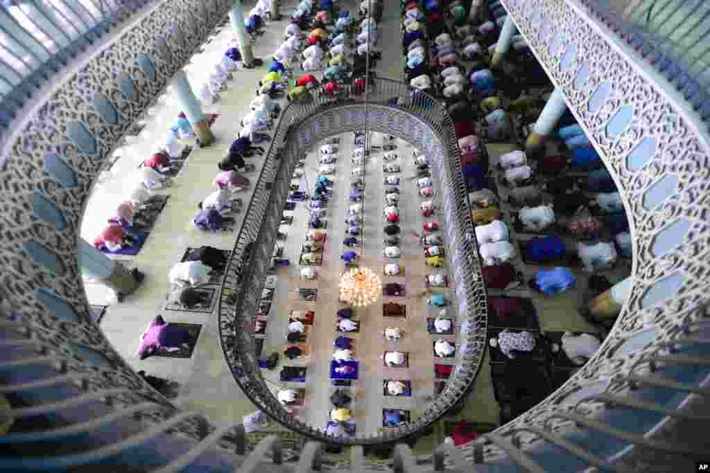 Bangladeshi Muslims offer Eid al-Fitr prayers, marking the end of the holy month of Ramadan, inside the Baitul Mukarram Mosque in Dhaka, Bangladesh.