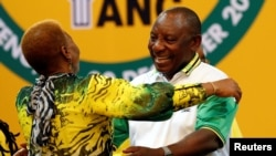 FILE: Deputy president of South Africa Cyril Ramaphosa greets an ANC member during the 54th National Conference of the ruling African National Congress (ANC) at the Nasrec Expo Center in Johannesburg, South Africa, Dec. 18, 2017.