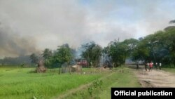 Smoke are seen here in the sky above a village in Yathay Taung Township. Aug. 27th, 2017.