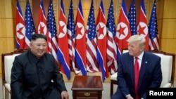 Tổng thống Mỹ Donald Trump và lãnh đạo Triều Tiên Kim Jong Un.
