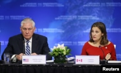 U.S. Secretary of State Rex Tillerson speaks with Canada's Minister of Foreign Affairs Chrystia Freeland during the Foreign Ministers' Meeting on Security and Stability on the Korean Peninsula in Vancouver, British Columbia, Canada, Jan. 16, 2018.