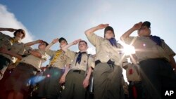 "In this Saturday morning, May 21, 2011 file photo, Boy Scouts salute during a ""camporee"" in Sea Girt, N.J. The Wednesday, Oct. 11, 2017 (AP Photo/Mel Evans)"