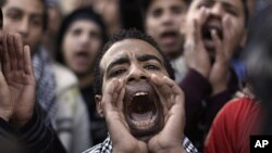 An Egyptian student shouts anti-military slogans during a protest as part of a general strike in Cairo University, February 11, 2012.