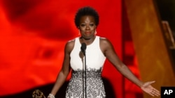 "Viola Davis accepts the award for outstanding lead actress in a drama series for ""How to Get Away With Murder"" at the 67th Primetime Emmy Awards, Sept. 20, 2015."