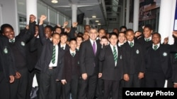 Sadiq Khan gathers with current students during a 2011 visit to his school in London's ethnically diverse Tooting neighborhood. (Photo courtesy of Ernest Bevin College)