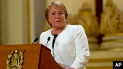 FILE - Chilean President Michelle Bachelet's popularity has fallen as corruption scandals, natural disasters thwart her reform plans, Guatemala City, Jan. 2015.