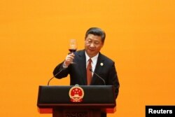 FILE - Chinese President Xi Jinping makes a toast at the welcoming banquet at the Great Hall of the People during the first day of the Belt and Road Forum in Beijing, China, May 14, 2017.