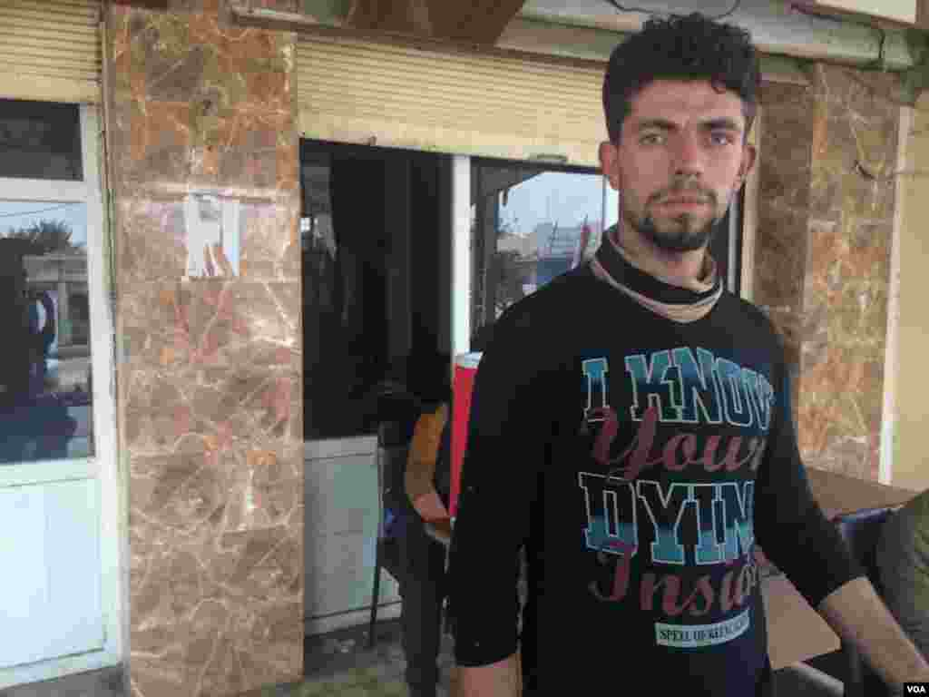 Obayda left six months ago, returning only after IS had been driven from town. Life under IS in Qayyarah, Iraq, he says, was becoming more dangerous as Iraqi forces grew closer, Oct. 24, 2016. (H. Murdock/VOA)