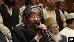 Maulana Sami-ul-Haq ,a Pakistani religious cleric and member of Taliban's negotiating team, speaks during a press conference in Lahore, Pakistan, Feb. 15, 2014.