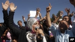 Yemeni students chant slogans calling on their president Ali Abdullah Saleh to leave the government and follow Tunisian ousted President Zine El Abidine Ben Ali into exile during a protest in Sanaa, Yemen, 22 Jan 2011